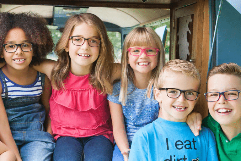 Children's eyecare - group of happy children all wearing glasses