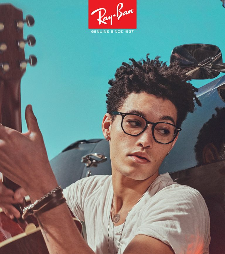 Ipswich opticians - young man with a guitar wearing Ray-Ban glasses