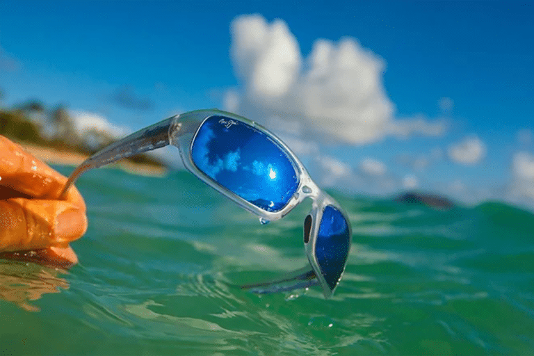 Sports sunglasses - sunglasses with blue lenses over water