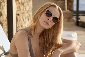 Sunglasses - woman relaxing on sun lounger wearing nice pair of sunglasses