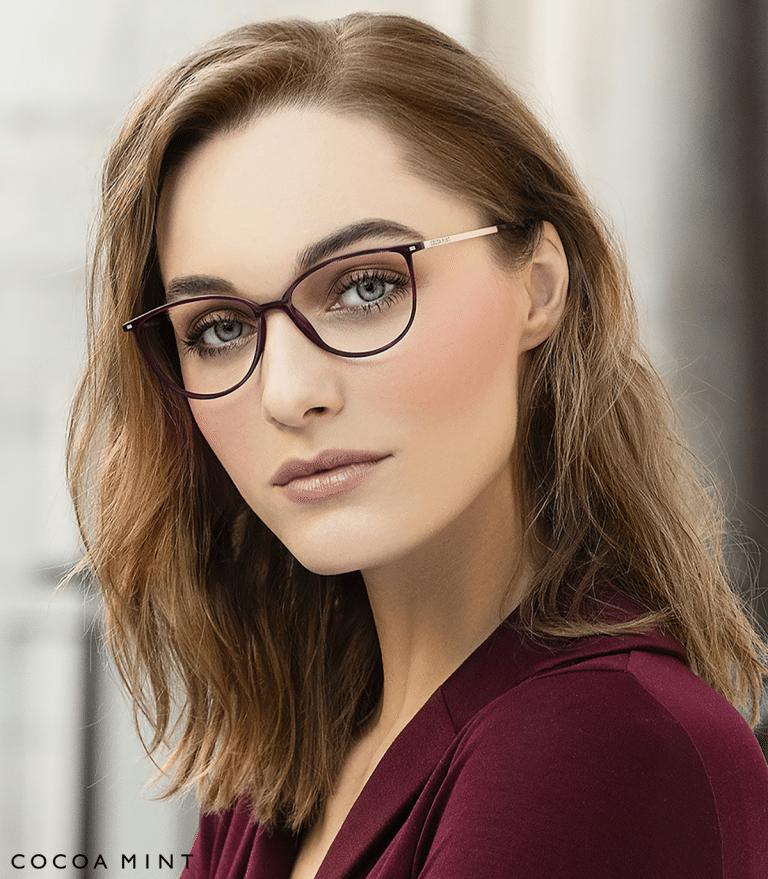 Halstead optician Pretty woman in burgandy jacket wearing black framed glasses