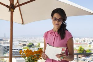 Lenses for glasses - Woman reading outdoors under umbrella with slight tint in her glasses