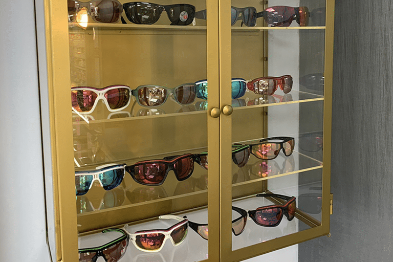 Sports sunglasses - gold case filled with sports sunglasses