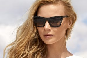 Lenses for sunglasses - woman with long blonde hair wearing sunglasses