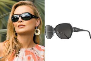 Lenses for sunglasses - woman wearing wrap around sunglasses from Maui Jim