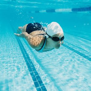 Ear plugs for swimming: Swimmer underwater