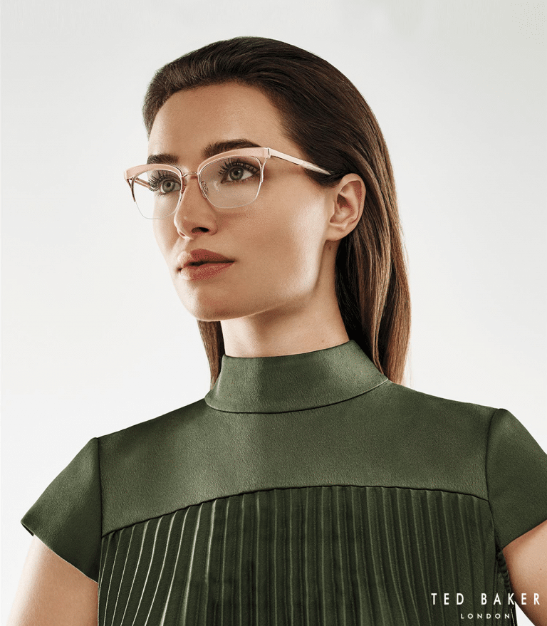 Leigh on Sea opticians Woman wearing green blouse and light pink glasses
