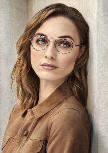 Varifocals - image of a woman wearing gold frame glasses
