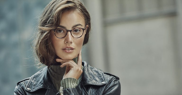 Petite woman wearing a pair of attractive glasses